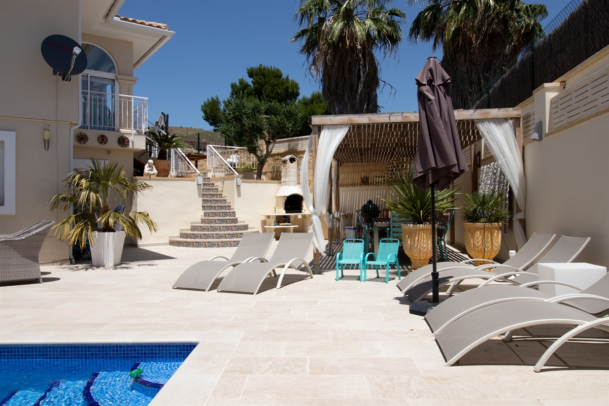 Terrace with comfortable sun beds