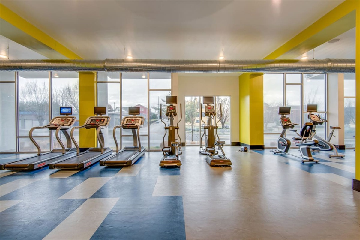 Gym with cardio machines, weight equipment, and a yoga/spin room are available for you to use!