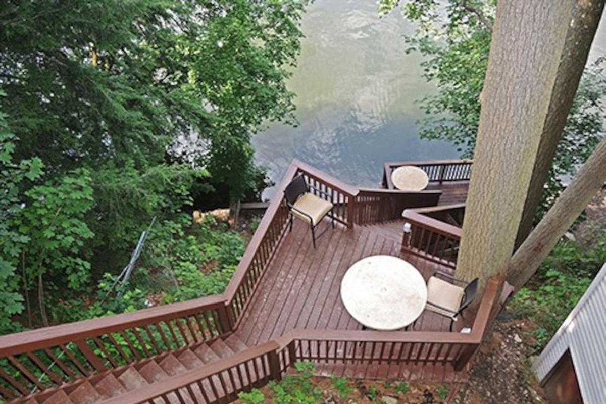Multi-tiered deck as seen from the top - Kayaks with PFD's, a fire pit and fishing poles are available at the water's edge