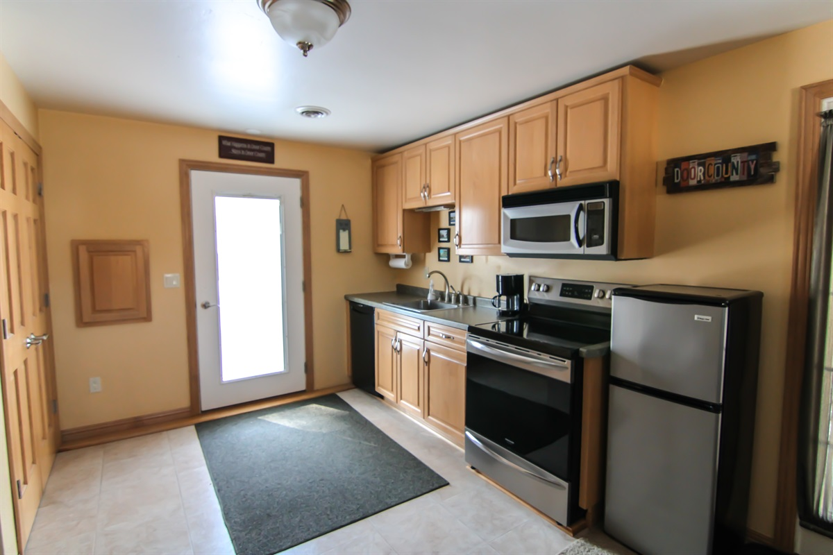 Open, fully equippted kitchen with TWO refrigerators, stove, oven, and microwave!