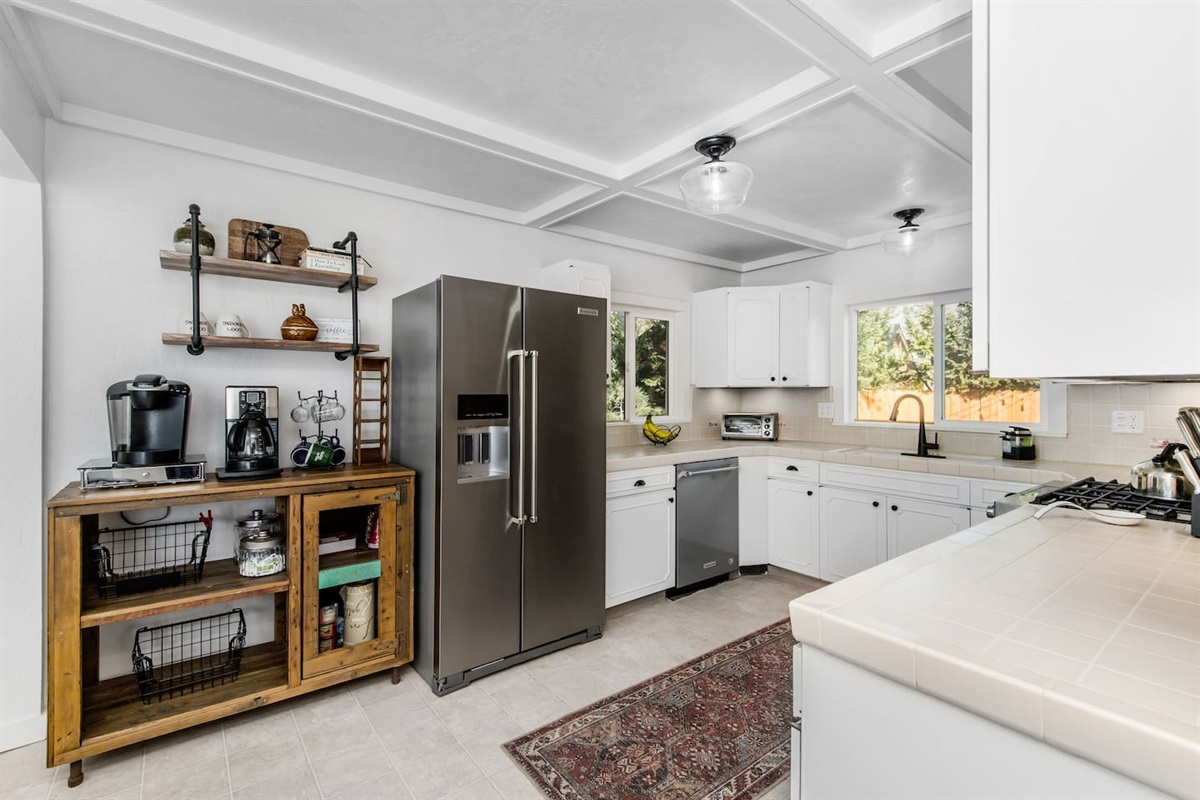 Kitchen (Lower Level): Big fully stocked kitchen with dinnerware and utensils with high quality pots and pans.