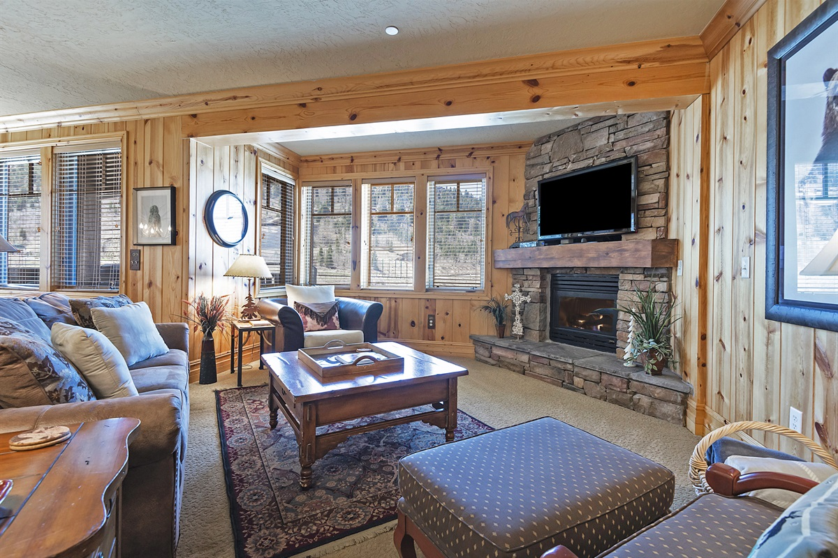 Living area with fireplace, TV, private deck, hot-tub
