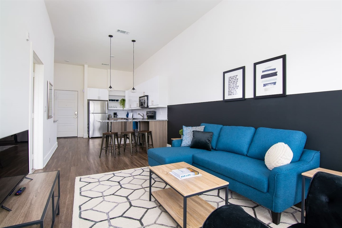 Open floor plan with comfy living room and updated kitchen! Sectional turns into a full sofa bed.
