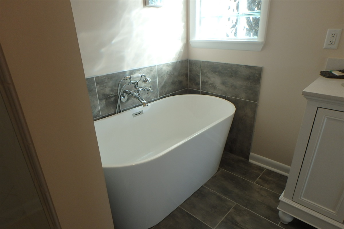 Free standing tub in completely renovated master bath
