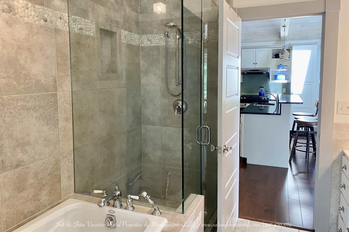 Full bath opens to kitchen/livingroom