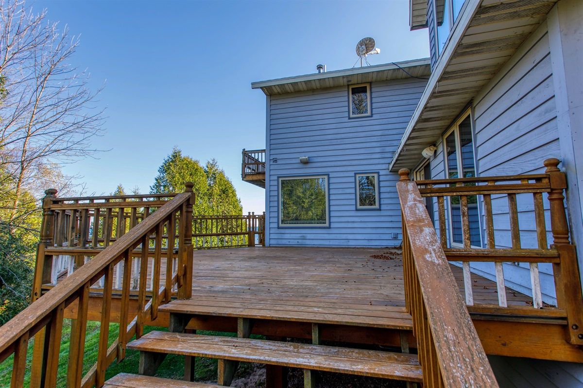 Main deck. Perfect for outdoor gatherings! Total of 4 wood decks and a huge waterfront concrete patio. 3,000 SF of decks!