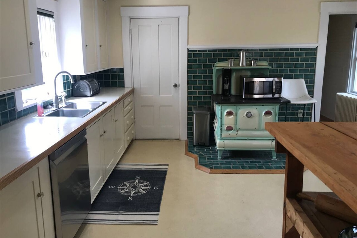 Fully equipped kitchen with bar for extra seating.