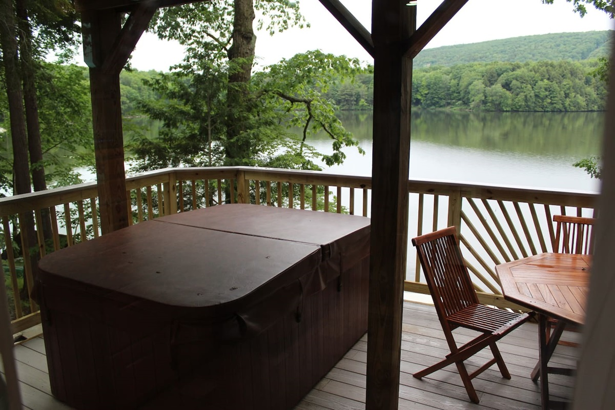 Lower level deck with hot tub overlooking the lake
