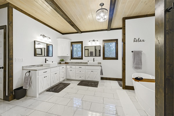 Master bath sutie with double vessel sinks and soaking bathtub