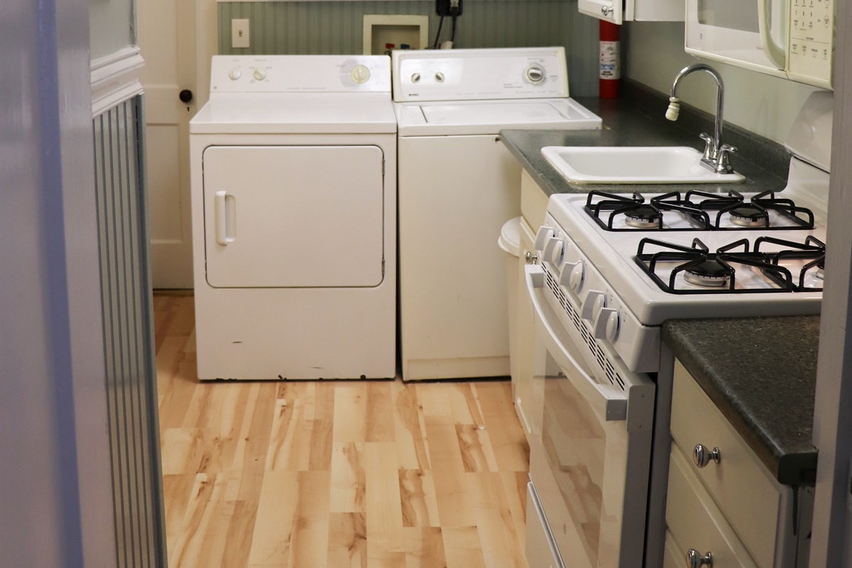 Kitchen complete with washer & dryer.