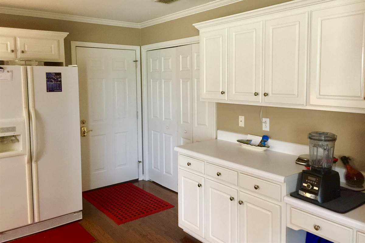 Laundry area is off kitchen