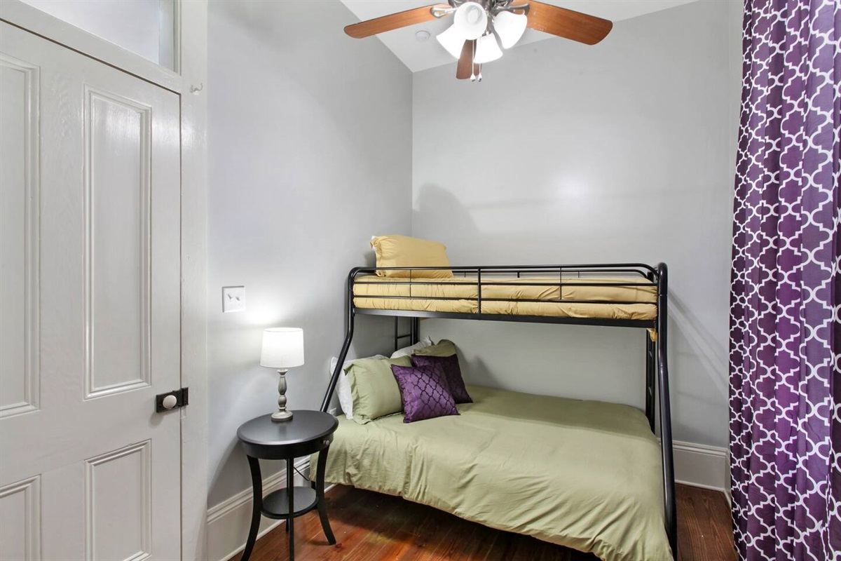 Bedroom 1. 1 full bed. 1 twin bed. Closet. Luggage rack.