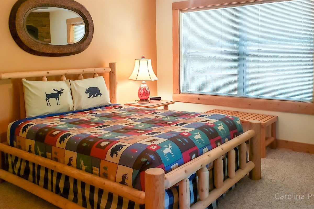 Main level master bedroom with queen size bed