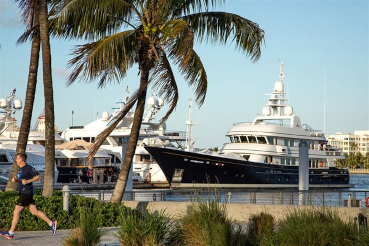 Take a stroll on the boardwalk near downtown Citiplace and see the amazing yachts and beauty of the Tropics!
