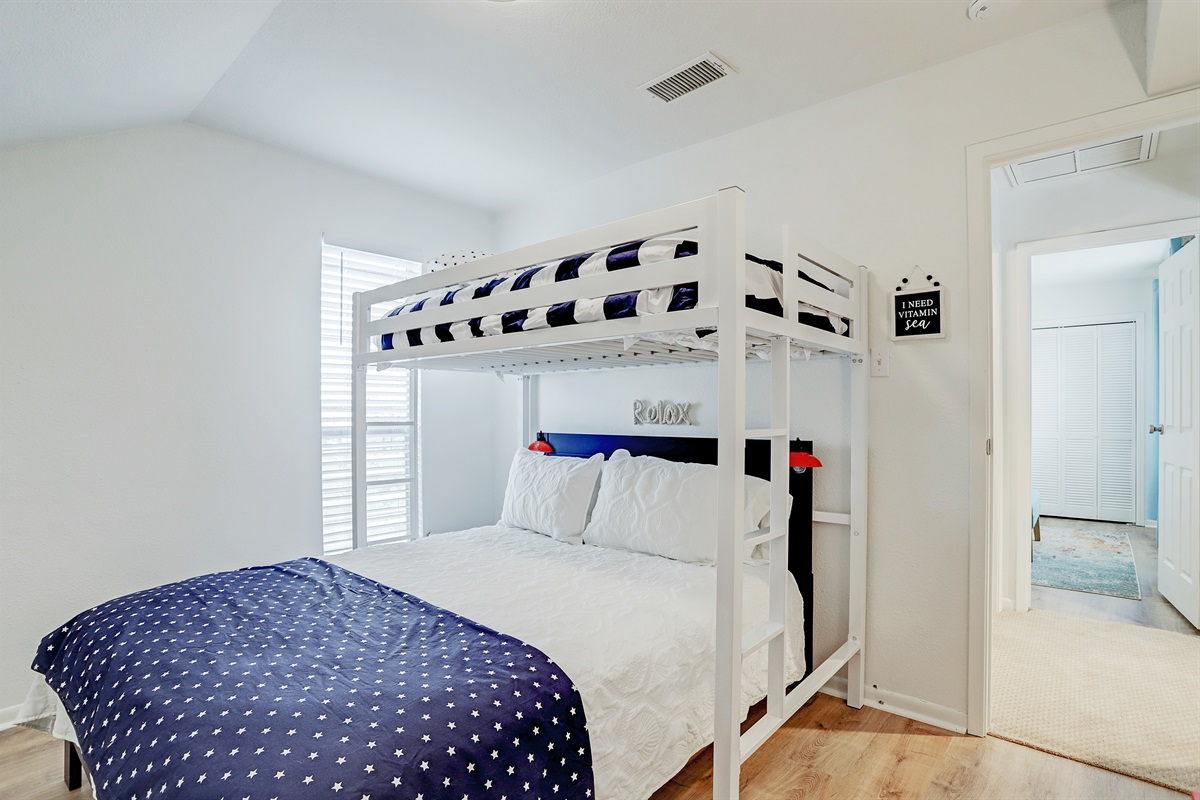 Upstairs Bunk room with queen bed and lofted twin