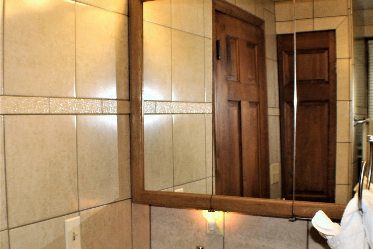 Fully tiled bathroom #1 with tub/shower combination and lots of storage space