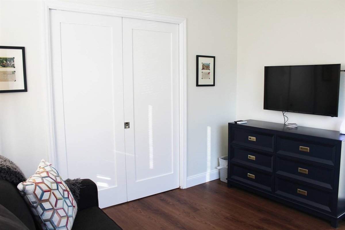 View inside the den space from the queen sized sofa bed couch with pocket doors locked. 40 inch HDTV comes with free 1,200 + Roku channel with movies, shows and music and over 25 live HD channels with antenna.