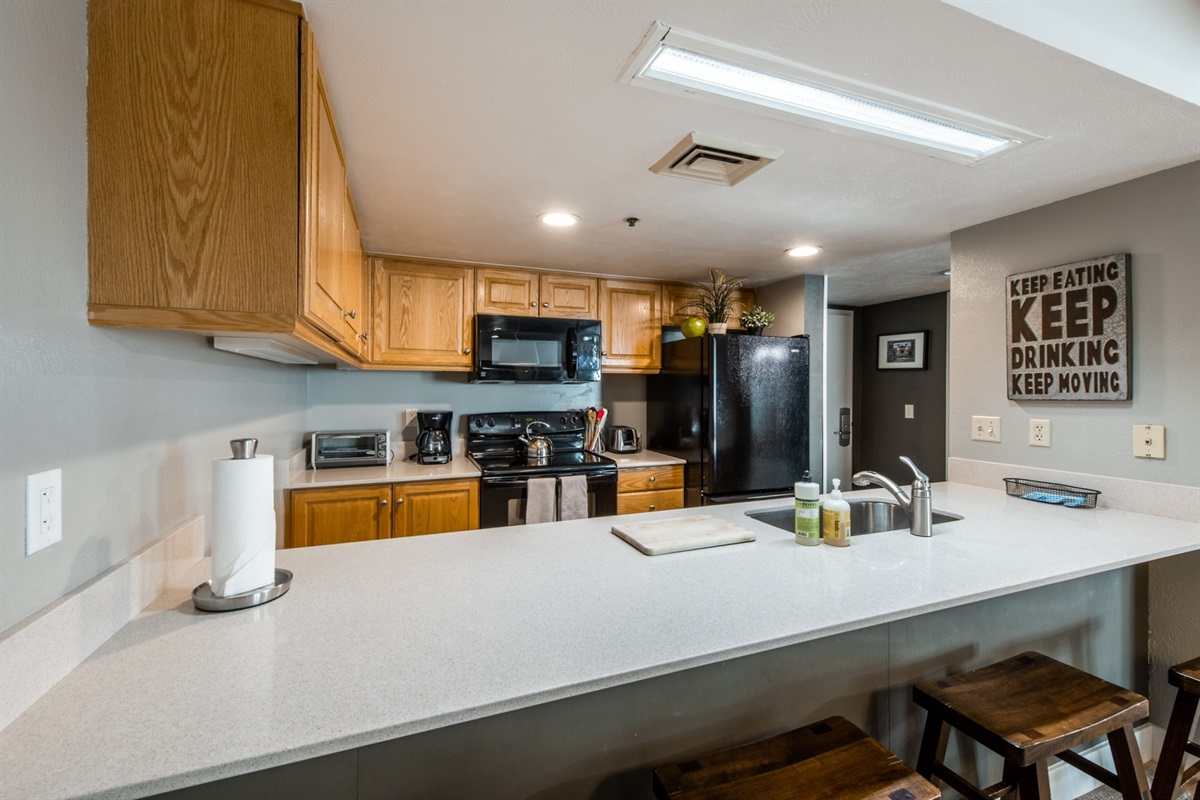 No need to eat out if you don't want to, there's plenty of space in the kitchen to cook for everyone. Large fridge, full-size dishwasher, full-size oven and microwave.