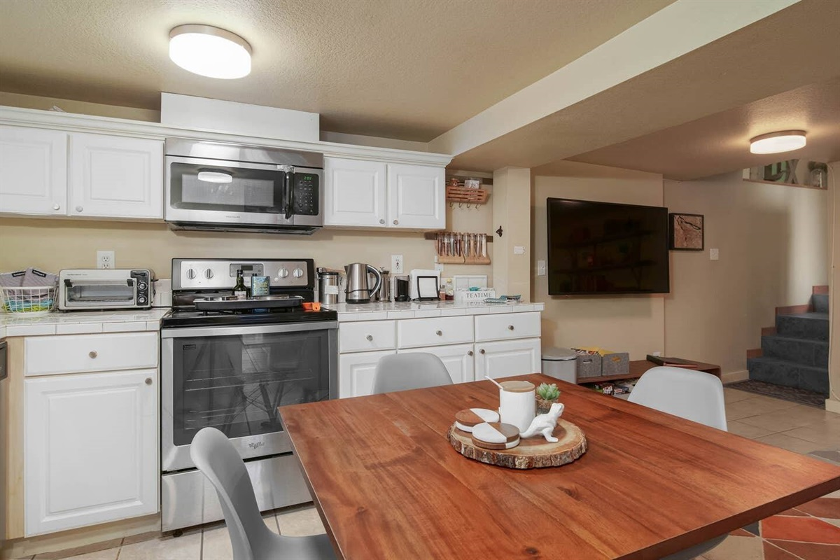 The kitchen is thoughtfully stocked, but cooking is limited to a two-burner hot plate and microwave.