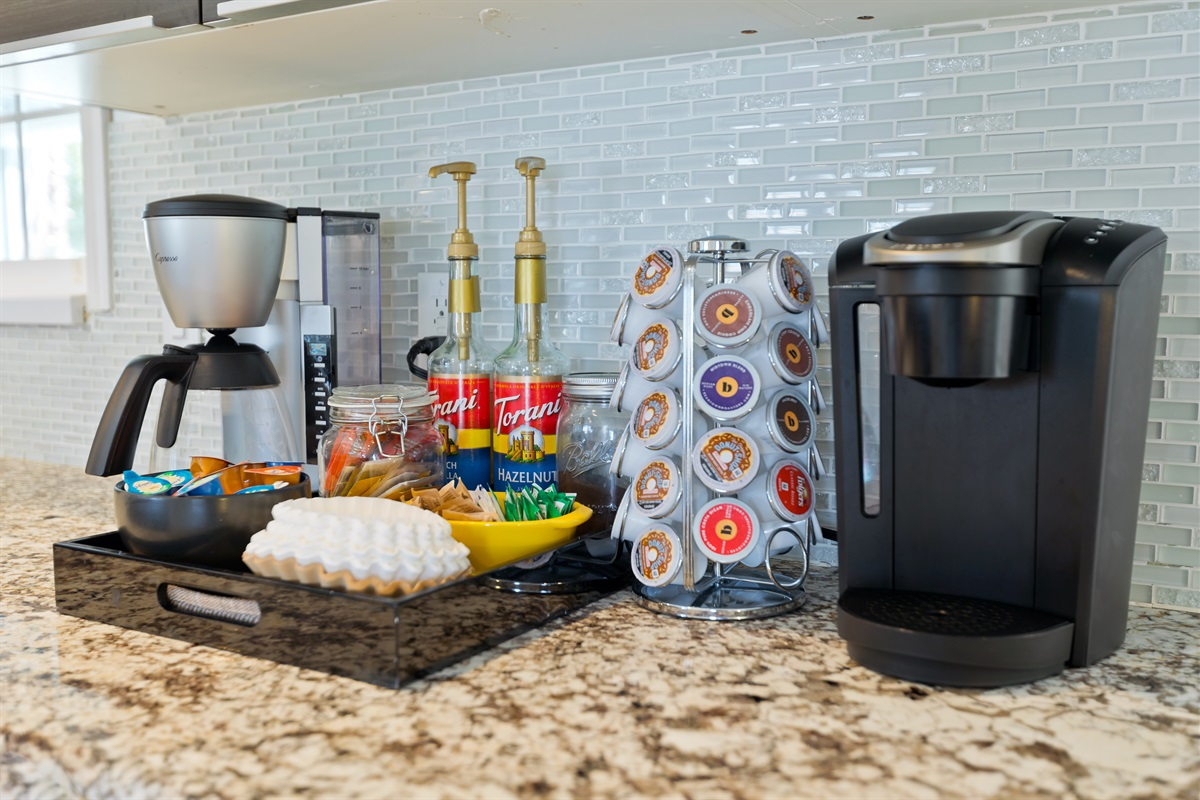 Our coffee and tea bar includes a Keurig classic, traditional coffee maker, and all your favorite fixings to enjoy a morning cup o' joe.