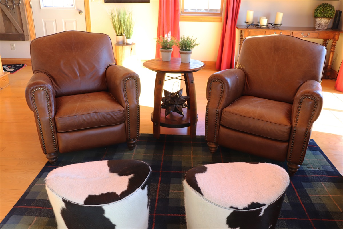 Relax in the plush leather recliners in the living room.