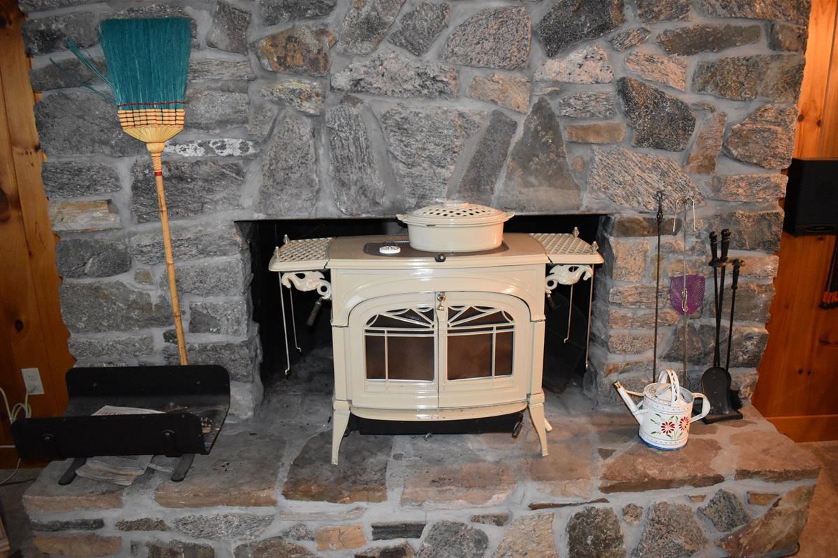 Stone fireplace with wood stove & glass doors. 38' TV w/ surr. snd. not pictured