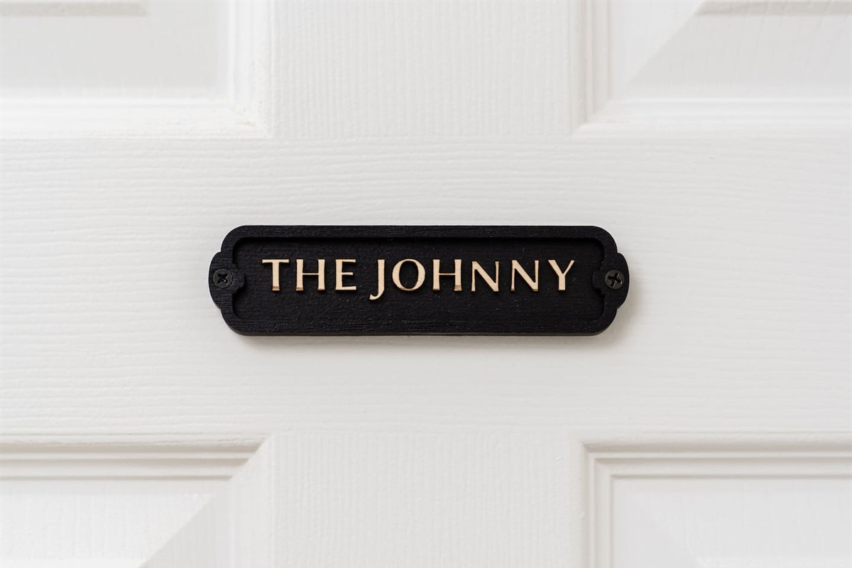 """Across the hall from """"The Dolly,""""  you'll find the third bedroom ,""""The Johnny"""""""