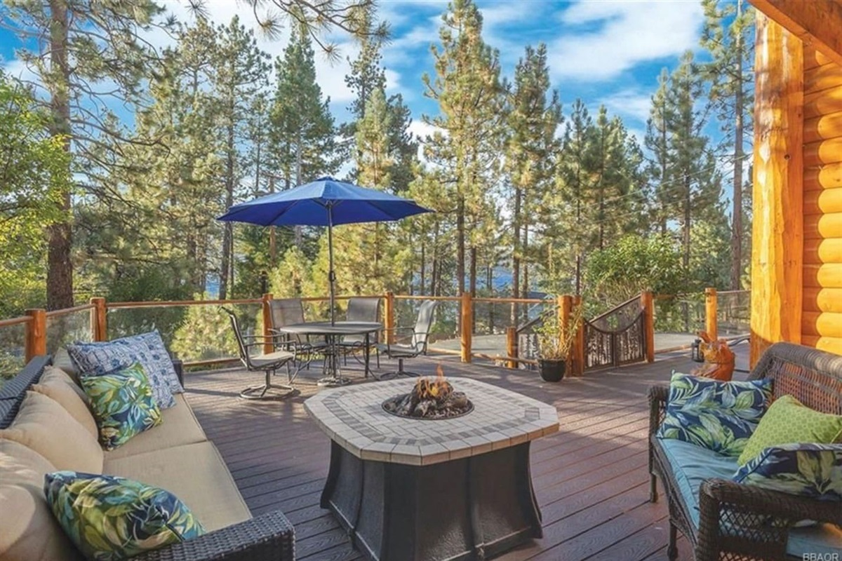 Large deck features sitting areas, outdoor dining table for 4, and gas fire pit.