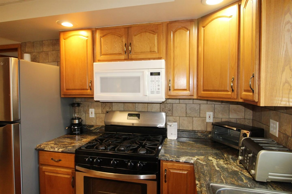 Kitchen with gas range and over the range microwave.  Combo K-cup coffee brewer, toaster, blender and much more!