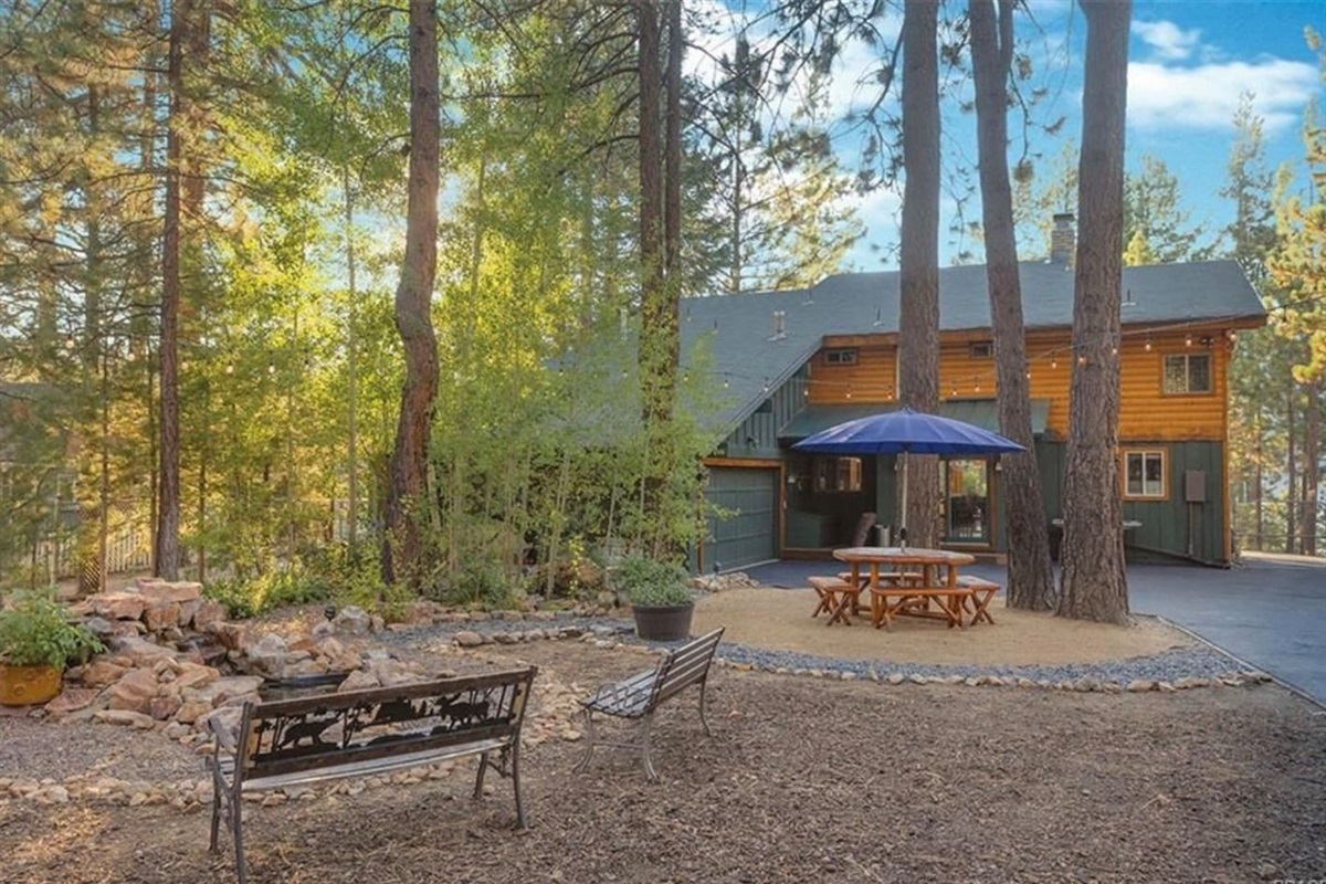 Waterview Cabin's private 1/2 acre lot has park-like features including a waterfall feature, picnic table, and benches.