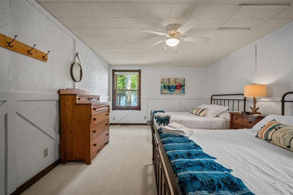The guest bedroom features two queen beds and sleeps up to four.