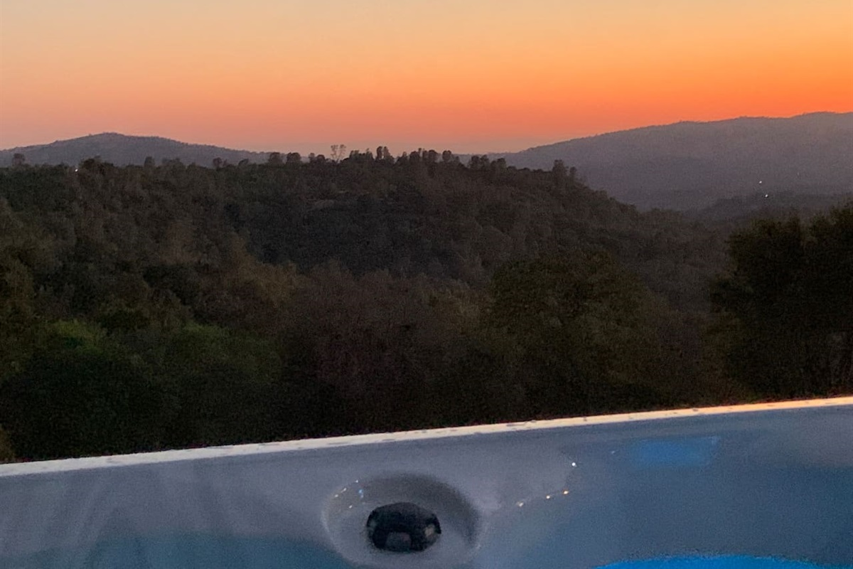 Soaking in the sunset view while soaking in the hot tub