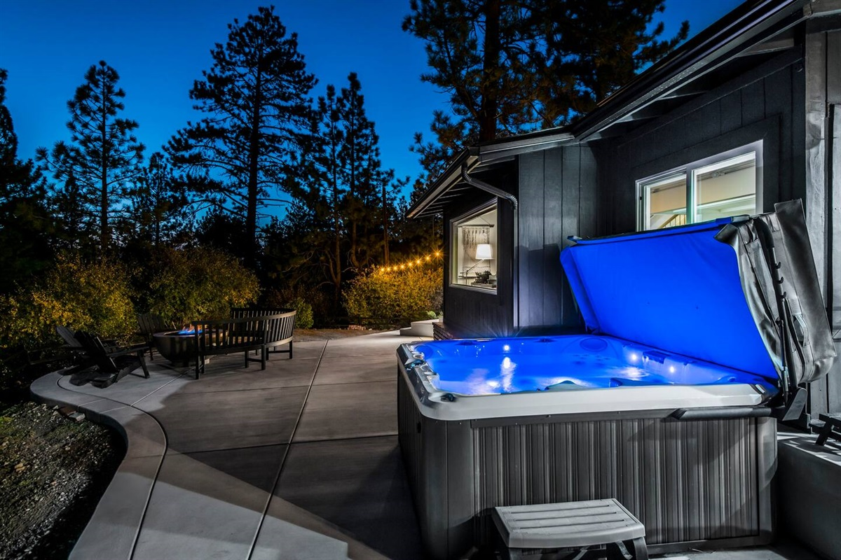 Enjoy a soak in hot tub or a glass of wine by the fire pit on the private back deck.