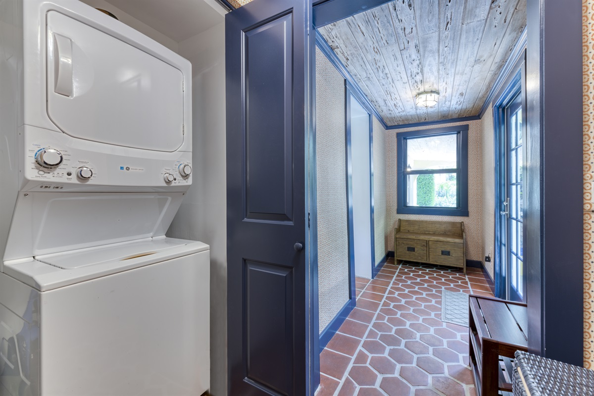Downstairs washer/ dryer with all cleaning products needed.