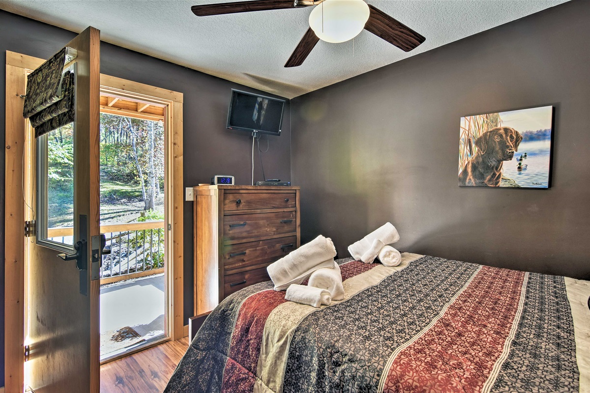 Enjoy direct porch access and a flat-screen TV in the first bedroom.