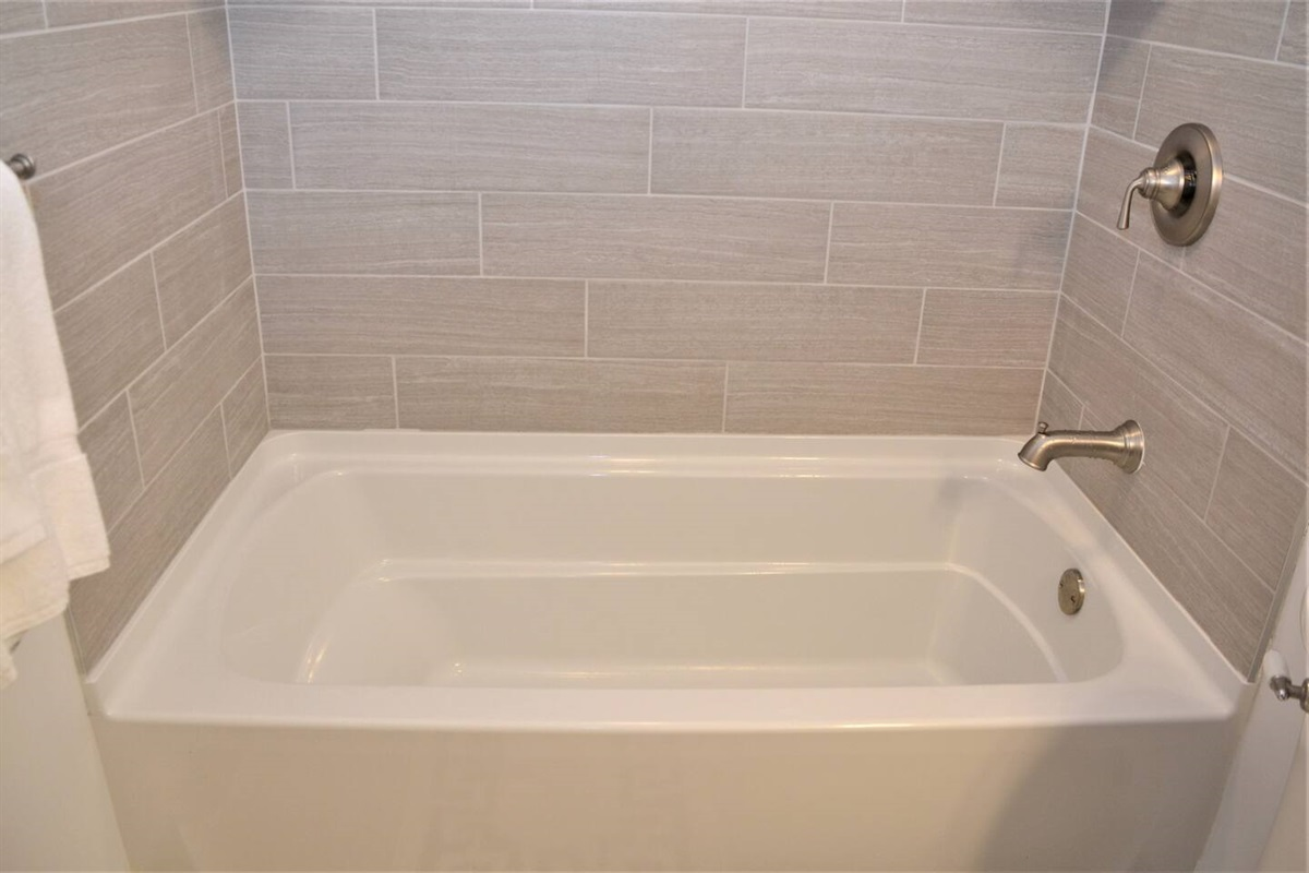 Enjoy a romantic tub for two in this deep soaking tub.