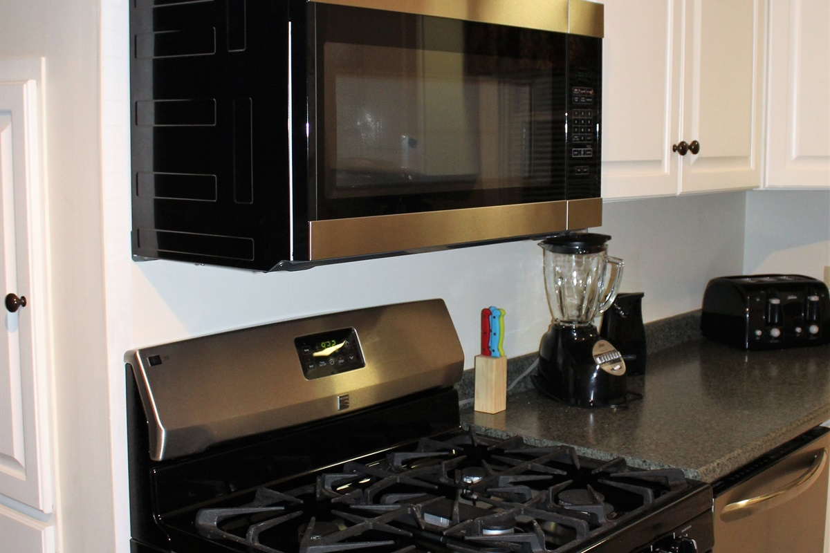 New stainless steel appliances in the main kitchen