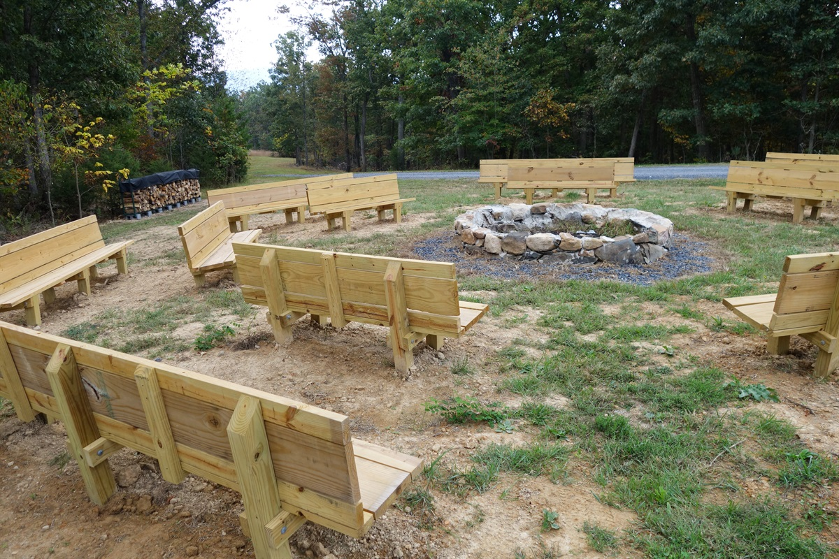 Campfire area with seating. Firewood provided