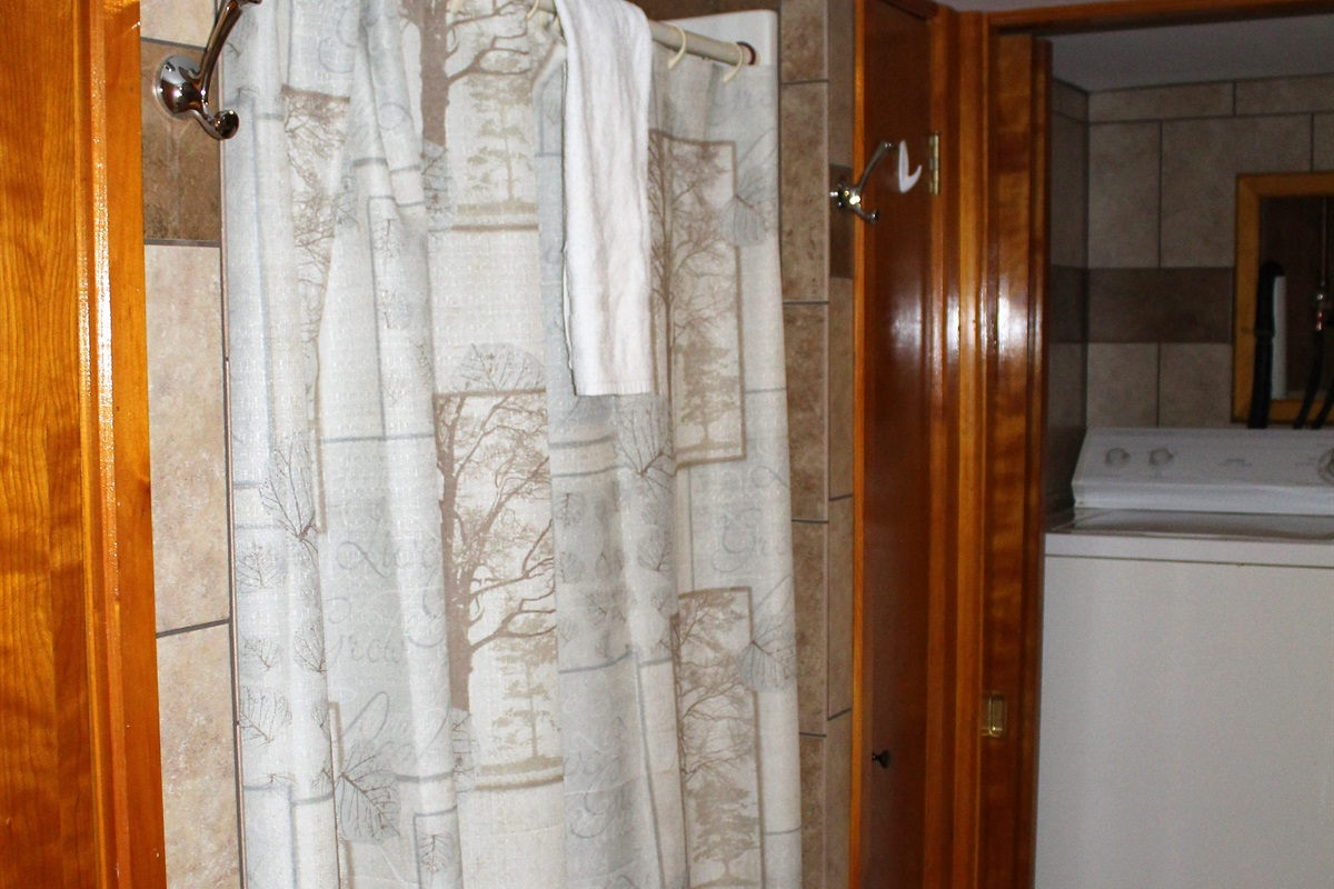 Bathroom with large shower and washer and dryer