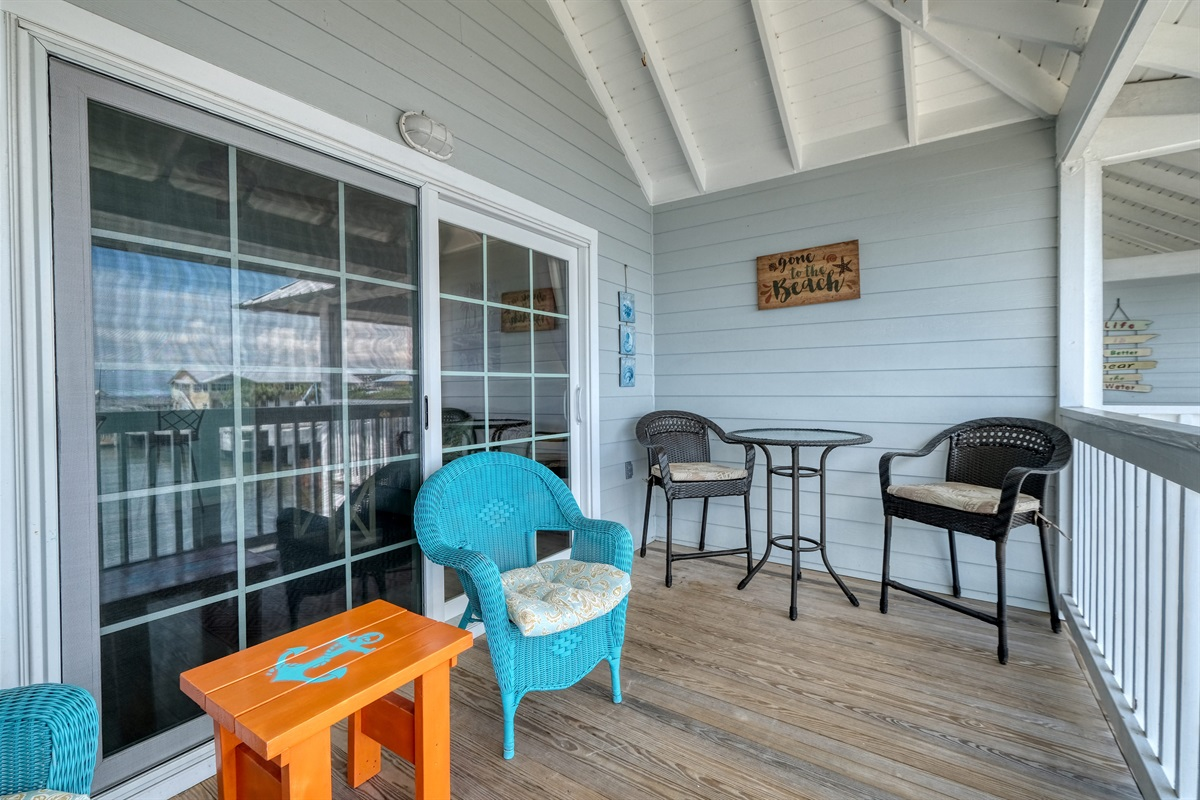 Bistro table and chairs on porch for outdoor dining
