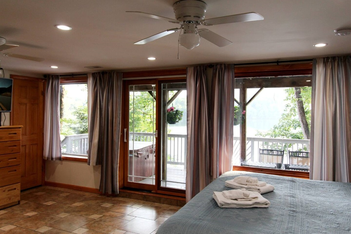Lots of windows for a perfect view of the lake, and just steps away from the hot tub on the deck.