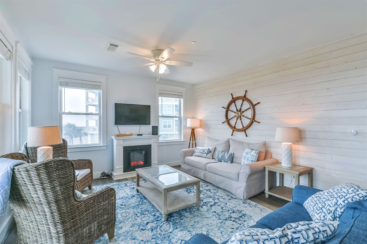 Living room is open with a beachy flair