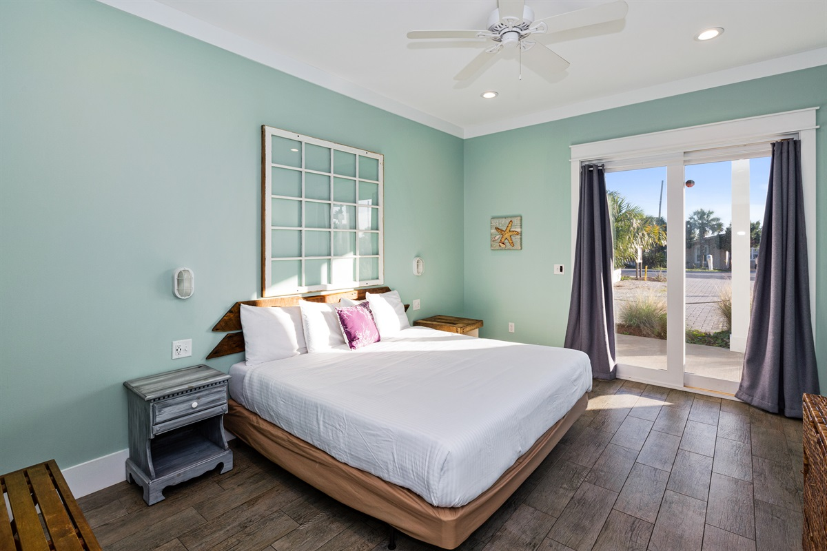 The Surf room is a wheelchair accessible king bedroom with a low profile box spring, an oversized walk in closet perfect for a pack n play or crib, sliding glass doors leading to the covered front patio, and access to a wheelchair accessible bathroom