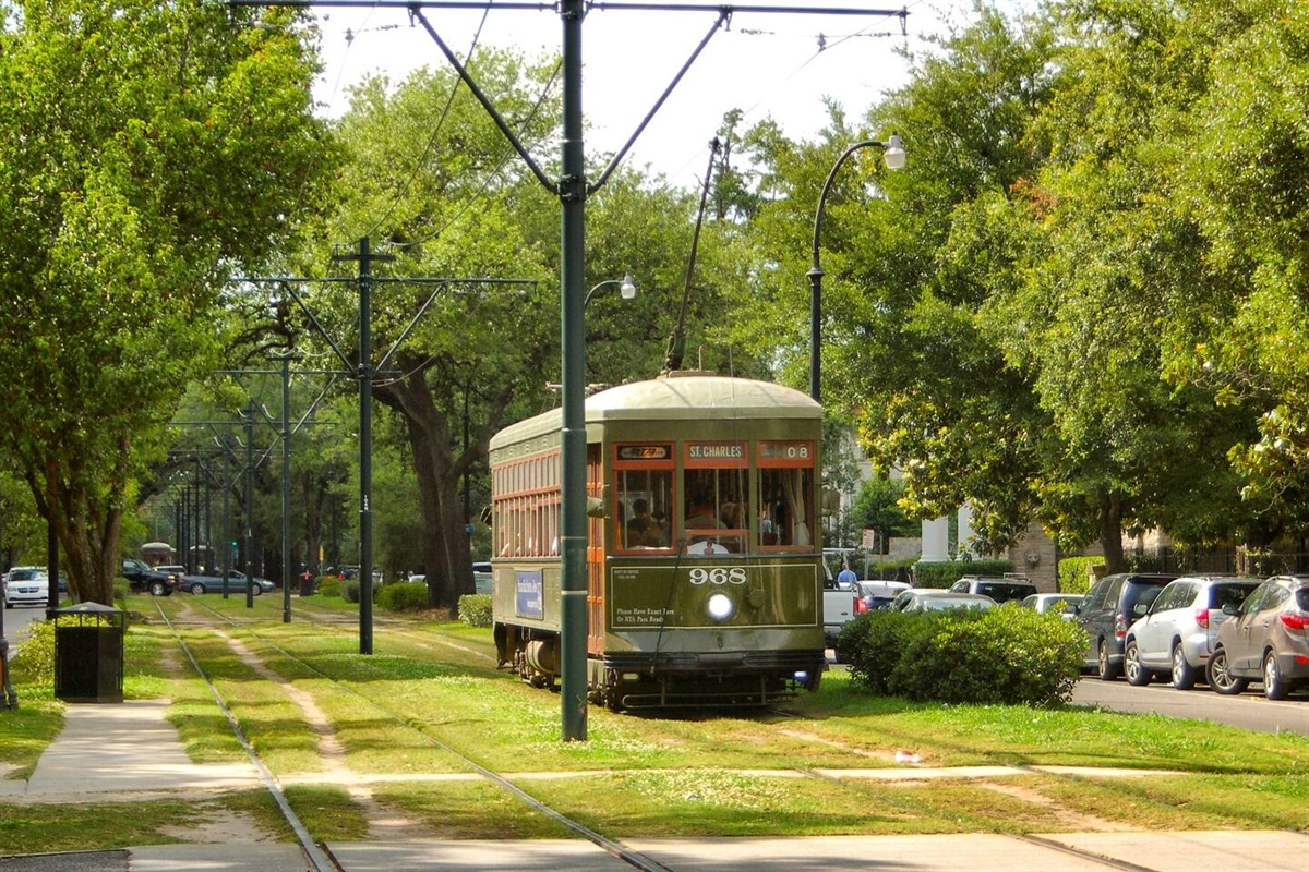 Take the street car down historic St Charles Ave to visit the French Quarter.