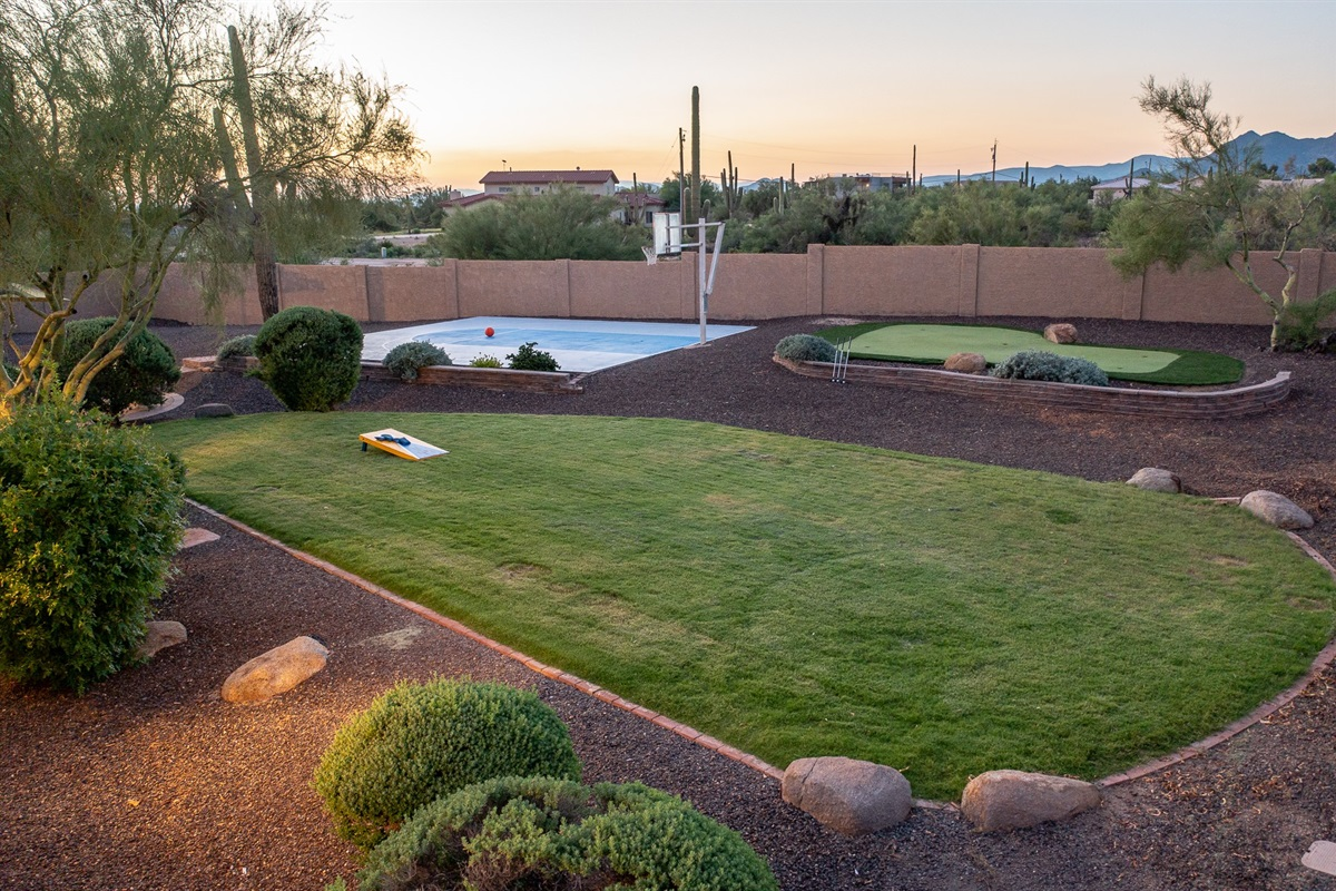 Large Grassy play area great for the kids, corn hole or just relax..