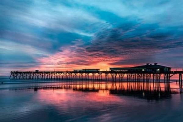 Sunglow Pier and Crabby Joe's Restaurant are a short walk away on the beach.
