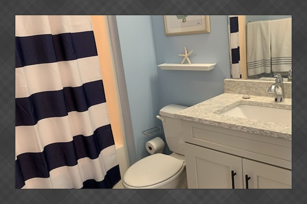 Stylish hall bathroom is right outside the second bedroom.