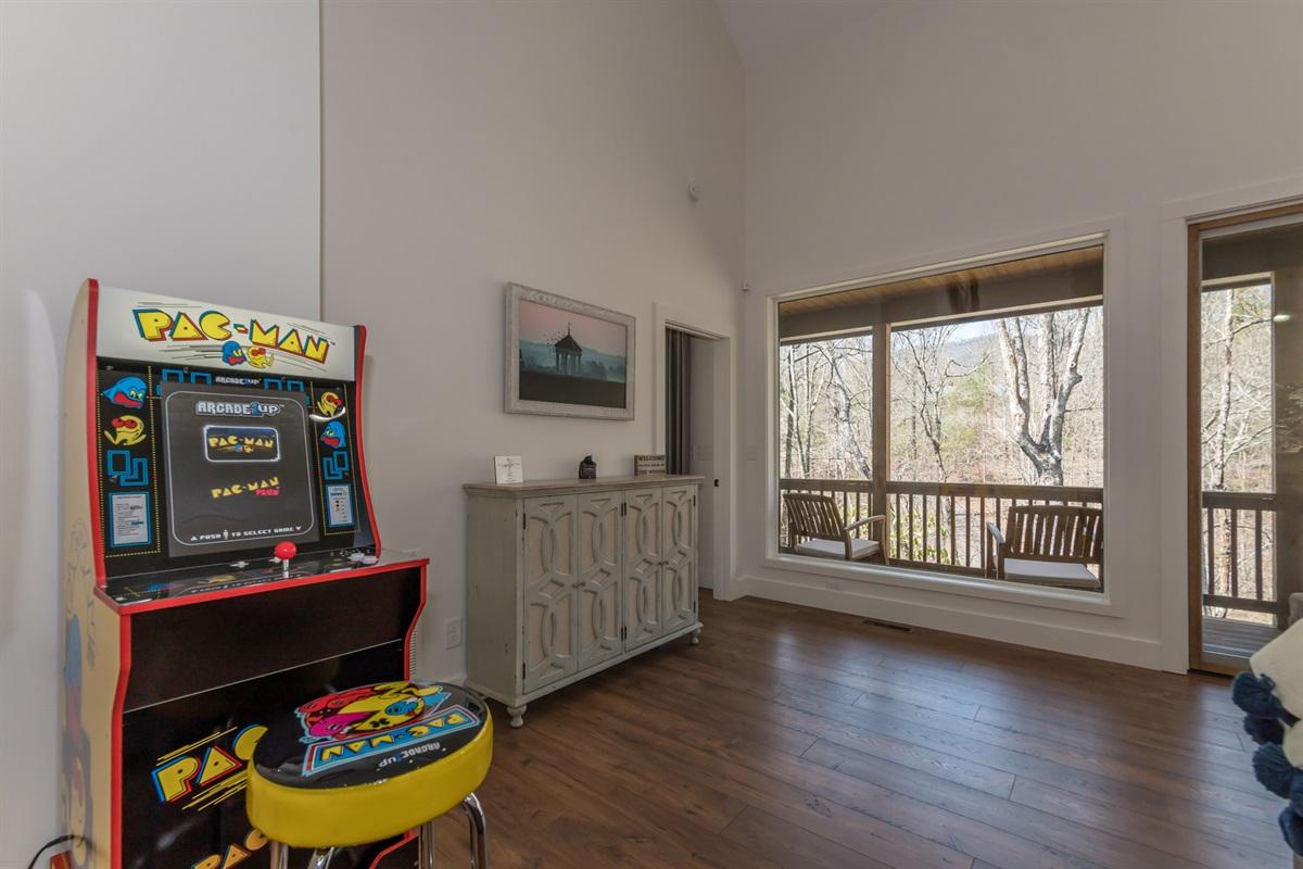 PacMan Arcade Game plus Board Games in Cupbord