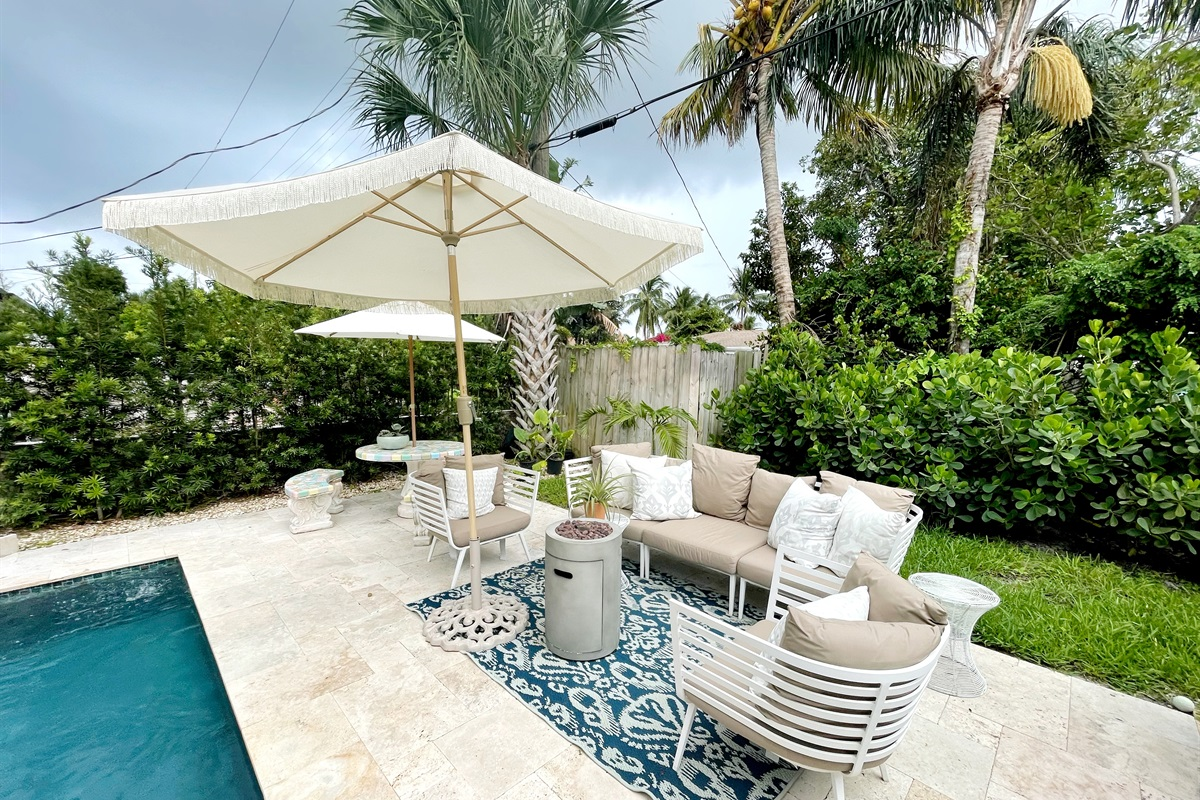 Magnificent 3 Bed/ 2 Bath home in the Historic & popular Elcid are in West Palm Beach! Stunning pool, yard, outdoor lounging & dining, fire pit & more! 5 Minutes to the Intercoastal & restaurants!