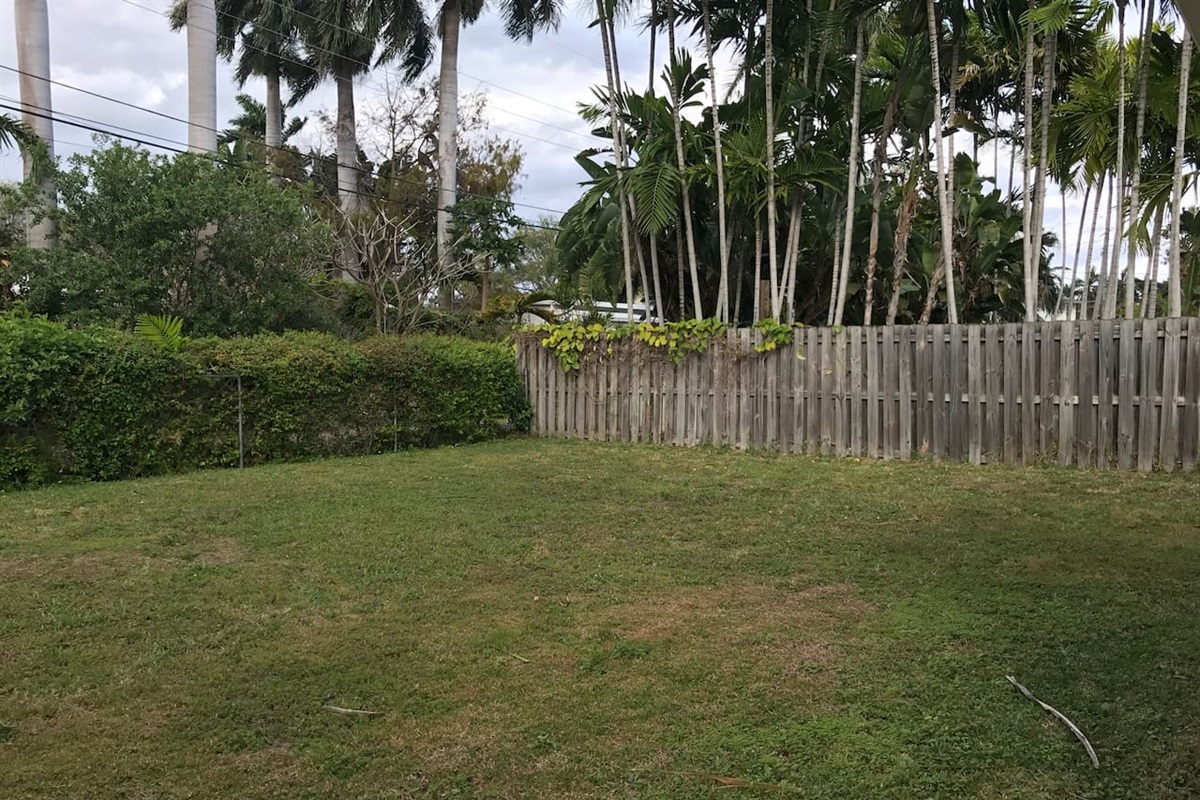 The large yard is fenced in on all sides and is great for catching some sun in privacy, playing soccer or football with the kids and just enjoying the beautiful South Florida weather